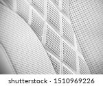 Leather interior of the luxury modern car. Perforated leather comfortable seats with stitching. Modern car interior details. Car detailing. Car inside. Leather texture background. - stock photo