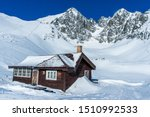 Mountains Hut In Winter High...