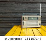old radio on yellow table  | Shutterstock . vector #151107149