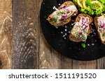 Stock photo marinated herring fillets on slices of bread on black stone 1511191520