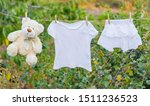 white clothes dry on a rope in... | Shutterstock . vector #1511236523