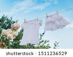 white clothes dry on a rope in... | Shutterstock . vector #1511236529