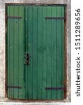 Old Green Wooden Doors On Ston...