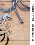 Small photo of Necessary set of tools for plumbers on wooden background indispensable for master