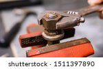 Loosening rusty nut using an...