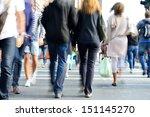 Motion blurred pedestrians - stock photo
