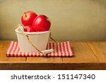 Apples In Wooden Bucket On...