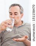 ill man taking medication... | Shutterstock . vector #151158470