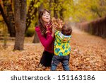 Mom And Son Throw Autumn Leaves