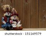 Boy And Girl Scarecrows Sittin...
