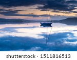 Sunrise Waterscape with Clouds and Boats at Koolewong, Central Coast, NSW, Australia.
