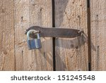 padlock on a old brown wooden... | Shutterstock . vector #151245548