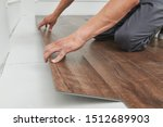 Worker Joining Vinyl Floor...