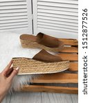 Stock photo brown female espadrilles close up on a platform on a background of white fur 1512877526