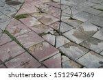 Cracked And Broken Sidewalk In...