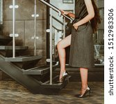 Small photo of Beautiful female legs in metal high-heeled shoes climb the stairs. Concept - woman and career, career growth. Confident independent lady beznes, the elegance of female behavior in business.