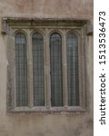 Small photo of Architectural Detail of an Old Arched Leaded Window in a Country House in the Village of Godolphin in Rural Cornwall, England, UK