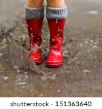 child wearing red rain boots... | Shutterstock . vector #151363640
