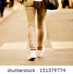 Close up of person walking on street - stock photo