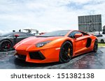 Постер, плакат: Unidentified racer with Lamborghini