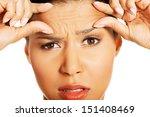 woman checking her wrinkles on... | Shutterstock . vector #151408469