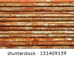 Stack Of Rusty Metal Pipes