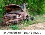 Old Rusty Abandoned Car In The...
