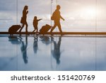 Silhouette Of Young Family Wit...