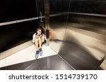 Small photo of Anxiety asian child girl having panic disease attack in an elevator,stress depressed teenage girl with mental health illness and narrow fears,suffocation, heart palpitation suffer from panic disorder