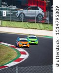 Small photo of Vallelunga, Italy september 14 2019. High angle view of asphalt circuit with two Smart electric engine racing car in overtaking action during the race