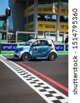 Small photo of Vallelunga, Italy september 14 2019. Side view of racing Smart fortwo electric engine car in first position on grid asphalt track circuit