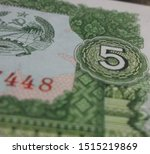 Denomination of 5 as seen here on the green 1979 Laos 5 Kip bill