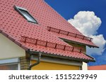 Snow Guard And Eves Gutter At...