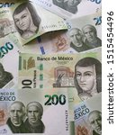 Small photo of Mexican banknotes of 200 pesos unorganized, background and texture