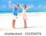 portrait of happy young couple... | Shutterstock . vector #151556576