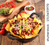 Small photo of mexican nachos chips- tortilla chip with bean, guacamole, corn and cheese