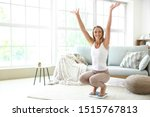Happy Young Woman On Scales At...