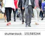 Diversified crowd crossing street - stock photo