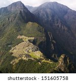 Machu Picchu and mountains seen from Wayna Picchu, the oposite direction. Slight mist. - stock photo