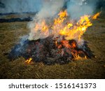 Burning Hay At Village In Dry...