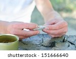 Male Hands Rolling A Cigarette...