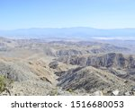 Joshua Tree National Park in California, USA, eerie rock formations, unique desert landscape and Joshua Trees on a hot day under a clear blue sky, Keys view, San Andreas fault view of Coachella Valley - stock photo