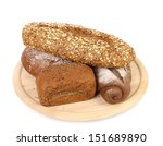 shot of assorted bread in a wooden tray - stock photo