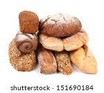 Brown and white loafs of bread. - stock photo