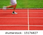 Athletic track with runner in motion - stock photo