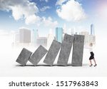 Small photo of Young businesswoman holding declining concrete graph over cityscape background. Concept of financial crisis and real estate market.