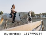 Girl Riding Horse While Mothe...