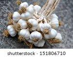 Garlic Bulbs Braid On A Gray...