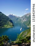 Cruise ship at Geiranger fjord in Norway - stock photo