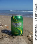 Small photo of Fresh beer Shandy lemon flavor on the beach. Spain 2019